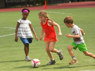 Camp Pikati campers playing a game of soccer at the Y.