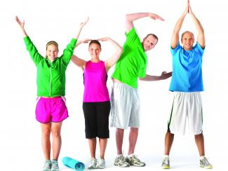 Adult YMCA members using their arms to spell out Y-M-C-A